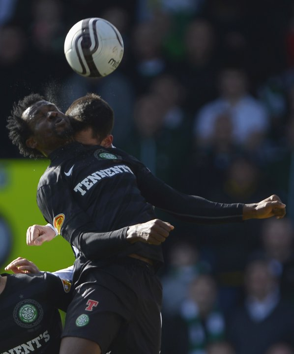 St Mirren's Steven Thompson challenges Celtic's Efe Ambrose during their Scottish FA Cup 6th round soccer match at St Mirren Park Stadium in Paisley, Scotland
