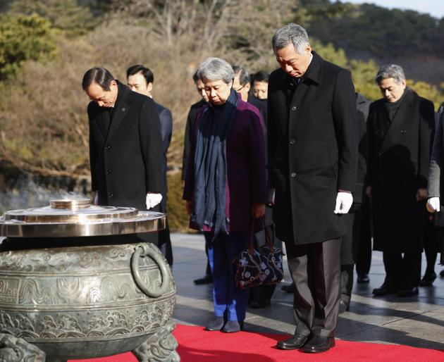 Singapore's PM Lee pays tribute during his visit to National Cemetery with wife Ho in Seoul