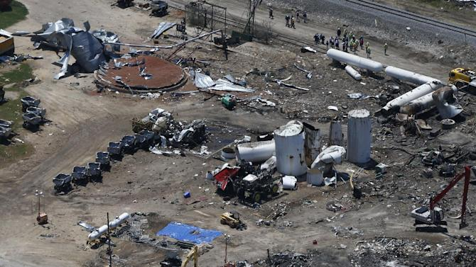 "FILE - The damage from the fertilizer plant explosion is seen from helicopters in accompanying President Barack Obama in West, Texas, in this April 25, 2013 file photo. The U.S Chemical Safety Board will tell a Senate committee Thursday June 27, 2013 that regulation of the dangerous chemicals used in the industry fall under a ""patchwork"" of standards that are decades old and are far weaker than rules used by other countries. The findings will be presented to the U.S. Senate Committee on Environment and Public Works. (AP Photo/Charles Dharapak, File)"
