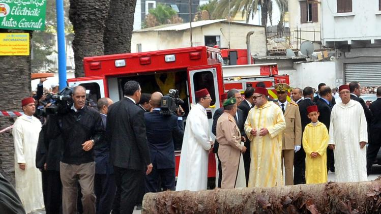 Morocco's King Mohammed VI and Crown Prince Moulay Hassan arrive at the scene after buildings collapsed in downtown Casablanca