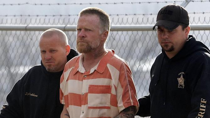 """FILE - In this April 2, 2013 file photo, Troy James Knapp, 45, is escorted by Sanpete Sheriff's deputies to the Sanpete County Jail in Manti, Utah. Knapp, known as the """"Mountain Man,"""" is accused of eluding authorities for at least four years while burglarizing remote cabins across Utah and is scheduled to be in court Monday, June 9, 2014 to resolve dozens of federal and state charges he's facing. (AP Photo/Rick Bowmer, File)"""