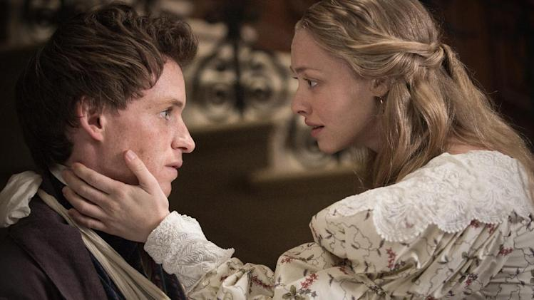 "This film image released by Universal Pictures shows Eddie Redmayne as Marius, left, and Amanda Seyfried as Cosette in a scene from ""Les Miserables."" (AP Photo/Universal Pictures, James Fisher)"