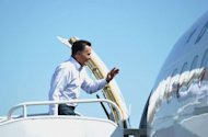 Republican presidential candidate Mitt Romney boards his campaign plane at Los Angeles International Airport. Romney hits the campaign trail hard this week to try to inject some fresh momentum into his flagging presidential bid as polls show his path to the White House narrowing.