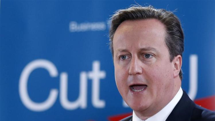 Britain's PM Cameron addresses a news conference during a EU leaders summit in Brussels