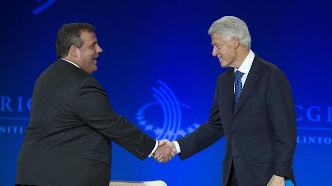 """Former President Bill Clinton, right, shakes New Jersey Gov. Chris Christie's hand as he arrives on stage during the Clinton Global Initiative (CGI) Meeting in Chicago, Friday, June 14, 2013. Clinton and Christie spoke during a closing session titled """"Cooperation and Collaboration: A Conversation on Leadership."""" (AP Photo/Scott Eisen)"""