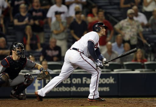 Gattis, Freeman lead Braves past Twins 5-4 in 10th
