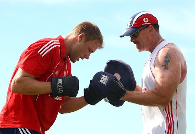 BRIDGETOWN, BARBADOS - MARCH 24:  England cricketer Andrew Flintoff (L) boxes with Reg Dickason during a fitness training morning at The Kensington Oval on March 24, 2009 in Bridgetown, Barbados. (Pho