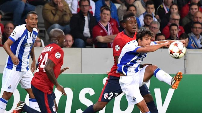 Lille's French forward Divock Origi fights for the ball with FC Porto's Portuguese midefielder Ruben Neves during the UEFA Champions League play-off round football Lille vs FC Porto on August 20, 2014 in Villeneuve d'Ascq