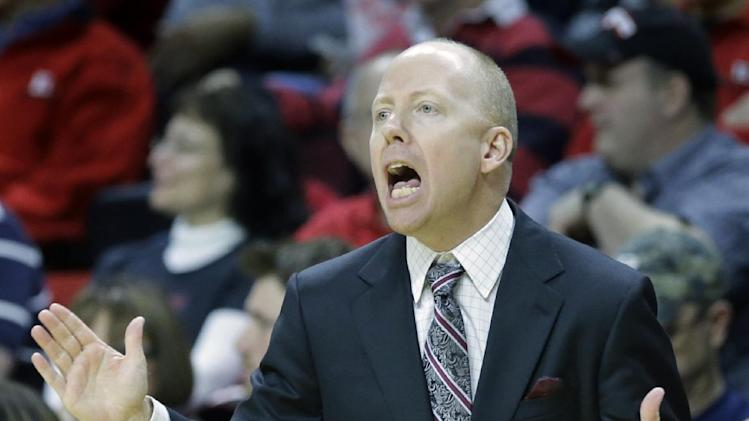 Cincinnati head coach Mick Cronin shouts to his players during the first half of an NCAA college basketball game against Rutgers Saturday, March 8, 2014, in Piscataway, N.J. Cincinnati won 70-66. (AP Photo/Mel Evans)