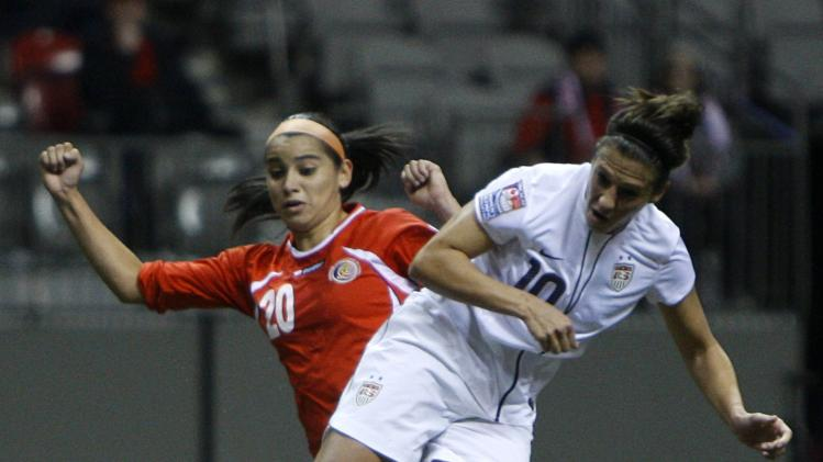 United States' Carli Lloyd (10) fights for control of the ball with Costa Rica's Wendy Acosta (20) during the first half of CONCACAF women's Olympic qualifying soccer game action at B.C. Place in Vancouver, British Columbia, Friday, Jan. 27, 2012. (AP Photo/The Canadian Press, Jonathan Hayward)