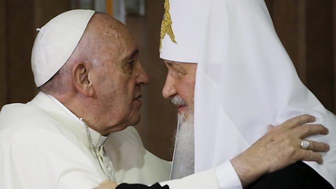 Pope Francis embraces Russian Orthodox Patriarch Kirill after signing a joint declaration on religious unity at the Jose Marti International airport in Havana