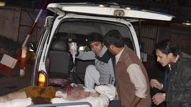 A Pakistani man who was injured in a bomb blast is brought to a hospital in a Quetta, Pakistan, Saturday, Feb. 16, 2013. A bomb ripped through a crowded vegetable market in a mostly Shiite neighborhood in a southern Pakistani city Saturday, killing scores of people in a horrific attack on the country's minority Muslim sect. (AP Photo/Arshad Butt)
