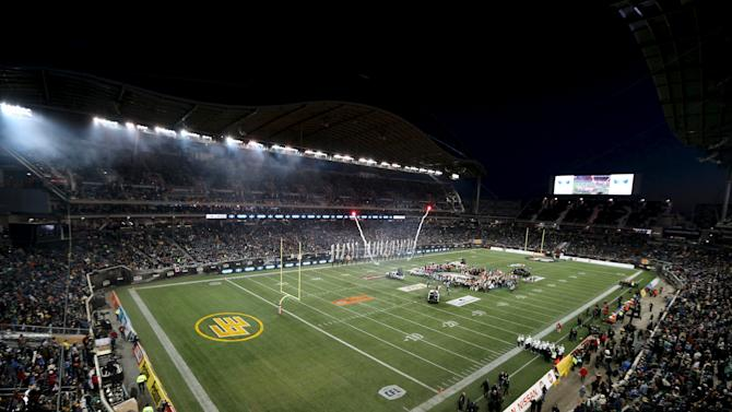 Fans watch the pre-game show during the CFL's 103rd Grey Cup championship football game between the Ottawa Redblacks and the Edmonton Eskimos in Winnipeg
