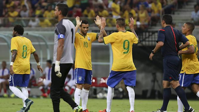 Luan of Brazil's Under-23 team celebrates with teammate Felipe Anderson after scoring against Dominican Republic's Under-23 team during their friendly soccer match in Manaus