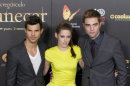 "FILE - In this Thursday, Nov. 15, 2012 file photo, from left, American actor Taylor Lautner, American actress Kristen Stewart and British actor Robert Pattinson pose during a photo call at the Spanish premiere of the film ""The Twilight Saga: Breaking Dawn-Part 2"" in Kinepolis Cinema in Madrid, Spain. Stewart, Pattinson and Lautner have walked their last ""Twilight"" red carpet with the arrival of the finale ""The Twilight Saga: Breaking Dawn - Part 2,"" and now must step into careers of their own using the superstardom the multi-billion-dollar franchise has provided them. ( AP Photo/Gabriel Pecot, File)"