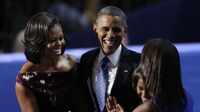 President Barack Obama laughs with his wife Michelle and his daughters Malia and Sasha after his speech to the Democratic National Convention in Charlotte, N.C., on Thursday, Sept. 6, 2012. (AP Photo/Lynne Sladky)