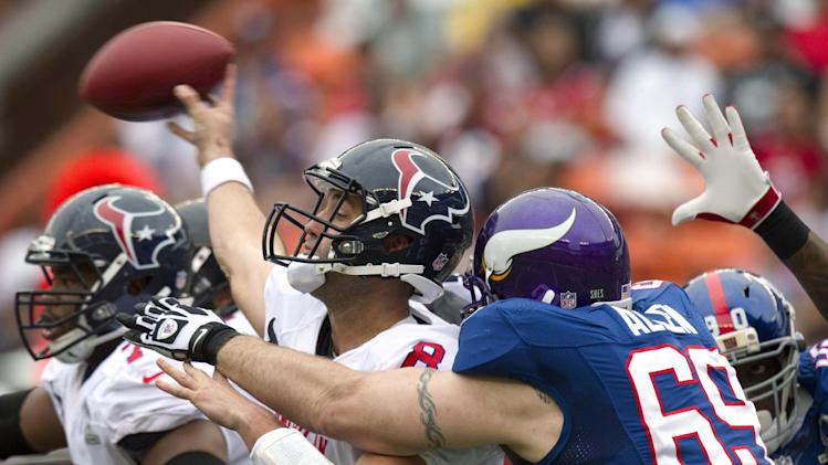 Houston Texans quarterback Matt Schaub (8) of the AFC manages to throw a pass just as Minnesota Vikings defensive end Jared Allen (69) of the NFC grabs Schaub during the third quarter of the NFL Pro Bowl football game in Honolulu, Sunday, Jan. 27, 2013. (AP Photo/Eugene Tanner)