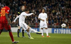 Real Madrid's Bale kicks the ball to score a goal against Galatasaray during their Champions League soccer match in Madrid