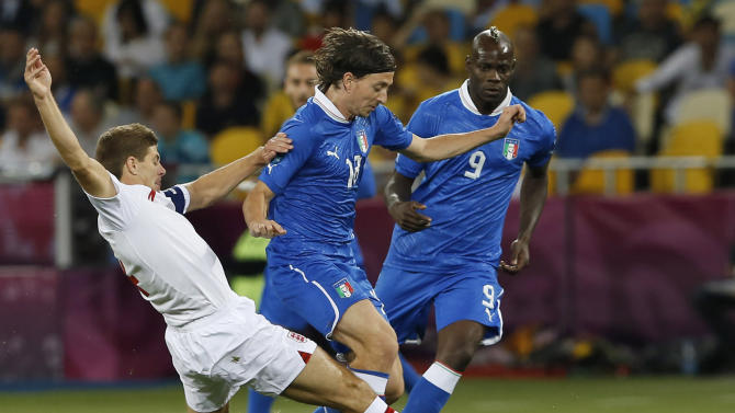 England's Steven Gerrard tries to stop Italy's Riccardo Montolivo during the Euro 2012 soccer championship quarterfinal match between England and Italy in Kiev, Ukraine, Sunday, June 24, 2012. (AP Photo/Kirsty Wigglesworth)