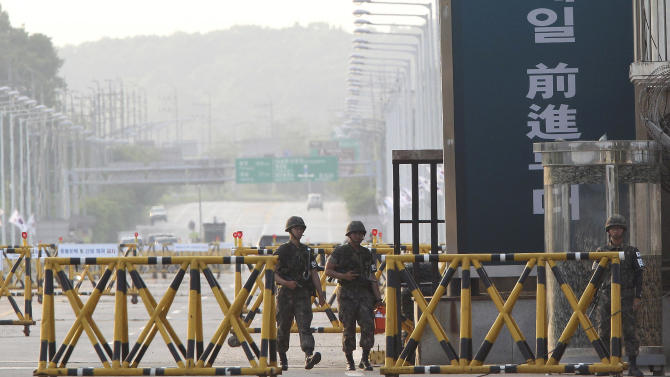 South Korean Army soldiers patrol on Unification bridge, which leads to the demilitarized zone, separating North Korea from South Korea in Paju, South Korea, Thursday, June 6, 2013. North and South Korea have agreed Thursday to hold talks on reopening a jointly run factory complex and possibly other issues, a hopeful sign for ending deteriorating relations that comes just as China and the U.S. prepare for a summit where the North is expected to be a key topic. (AP Photo/Ahn Young-joon)