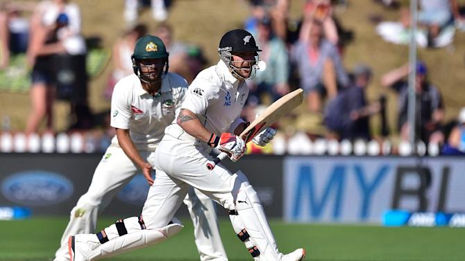 New Zealand skipper Brendon McCullum (R) plays a shot next to Australia's Joe Burns during the first Test in Wellington  on February 14, 2016