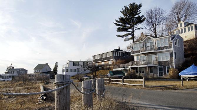 This photo of Wednesday, Feb. 22, 2012, shows houses on Little Neck in Ipswich, Mass. The dying wish of William Payne, one of the state's earliest settlers, created the nation's oldest charitable trust and eventually led tenants to build 167 cottages on this land he left for the seaside city. The rent money has generated some $2.4 million to help fund public schools over the last 25 years. Now, the trustees want to tear up the will and convert the property into condominiums. (AP Photo/Elise Amendola)
