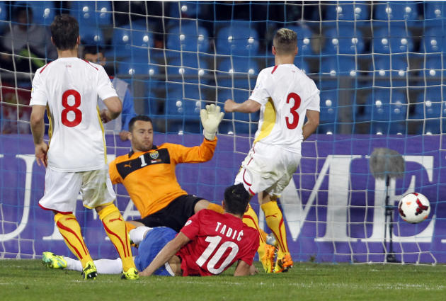 Serbia's Dusan Tadic, center, scores during their World Cup 2014 Group A qualifying soccer match against Macedonia, at the City Stadium in Jagodina, Serbia, Tuesday, Oct. 15, 2013