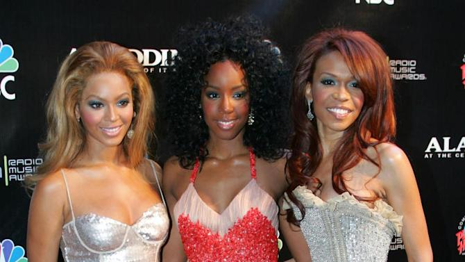 "FILE - This Oct. 25, 2004 file photo shows members of Destiny's Child, from left, Beyonce Knowles, Kelly Rowland and Michelle Williams at the Radio Music Awards at the Aladdin Theater for the Performing Arts in Las Vegas. The R&B trio announced Thursday, Jan. 10, 2013, that they will release a new track called ""Nuclear."" The song is the group's first new offering since 2004.  (AP Photo/Eric Jamison, file)"