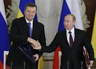 Russia's President Vladimir Putin (R) shakes hands with his Ukrainian counterpart Viktor Yanukovich during a signing ceremony after a meeting of the Russian-Ukrainian Interstate Commission at the Kremlin in Moscow, December 17, 2013. REUTERS/Sergei Karpukhin