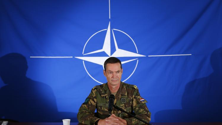 Dutch Brigadier-General Tak, head of NATO's crisis management centre, attends a news conference in Mons