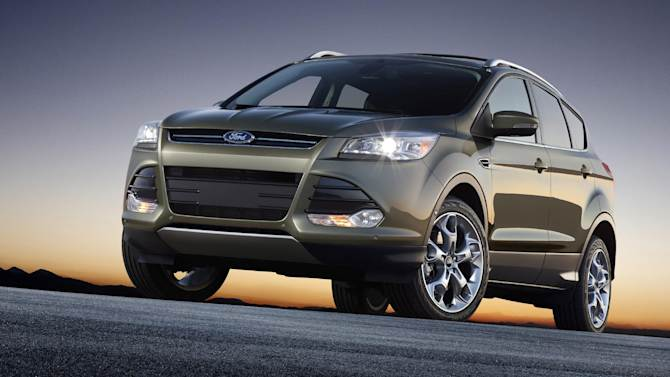 FILE - This undated file product image provided by the Ford Motor Co. shows the 2013 Ford Escape. A manufacturing problem at a company that makes fuel lines forced Ford to recall 11,500 of its brand-new Escape small SUVs and tell owners to stop driving them right away. Ford Motor Co. announced the recall Thursday, July 19, 2012, saying there was a risk of an engine fire. (AP Photo/Ford Motor Co., File)
