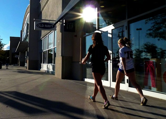 In this Monday, Sept. 24, 2012, photo, shoppers walk by stores at the Loop in Methuen, Mass. U.S. consumer confidence jumped this month to the highest level since February, bolstered by a brighter hiring outlook. The Conference Board said Tuesday, Sept. 25, 2012, that its Consumer Confidence Index rose to 70.3. That's up from 61.3 in August, which was revised higher. And it's the highest reading since February, when the economy added 259,000 jobs. (AP Photo/Elise Amendola)