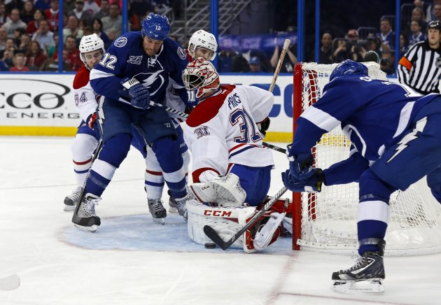 Canadiens' Price makes a save against Lightning's Crombeen during the second period of their NHL hockey game in Tampa
