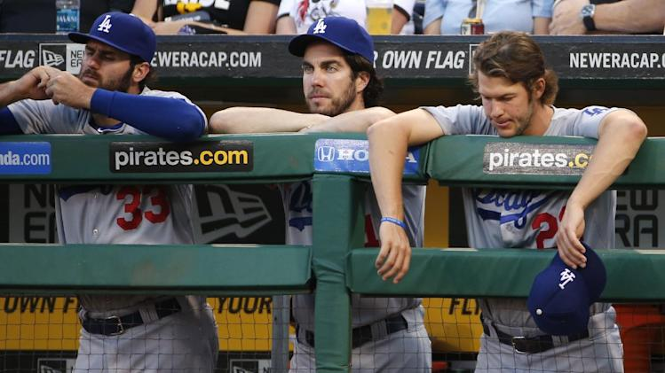Los Angeles Dodgers starting pitcher Clayton Kershaw, right, stands with pitcher Dan Haren, center, and Scott Van Slyke (33), left, during the third inning of a baseball game against the Pittsburgh Pirates in Pittsburgh Tuesday, July 22, 2014. (AP Photo)