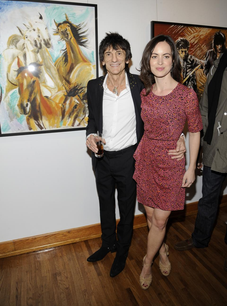 "Rolling Stones guitarist Ronnie Wood poses for a photo with his girlfriend, theatre producer Sally Humphreys, after a news conference unveiling his new art exhibition ""Faces, Time and Places"" on Monday, April 9, 2012, in New York. (AP Photo/Evan Agostini)"