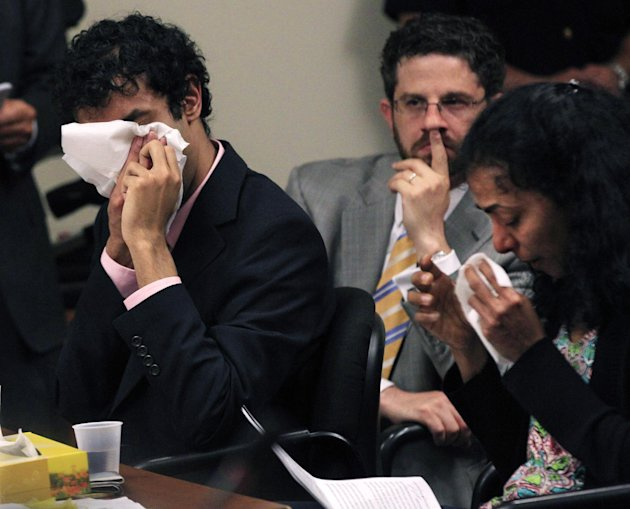 As defense attorney Philip Nettl, center, looks on Dharun Ravi, left,and his mother, Sabitha Ravi cry as she reads a statement during a sentencing hearing for Ravi in New Brunswick, N.J., Monday, May