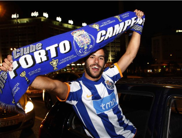 A Porto supporter celebrates the team's victory in downtown Lisbon