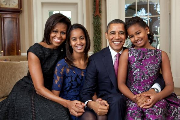 In this handout provided by the White House, (L - R) First Lady Michelle Obama, Malia Obama, U.S. President Barack Obama and Sasha Obama, sit for a family portrait in the Oval Office on December 11, 2