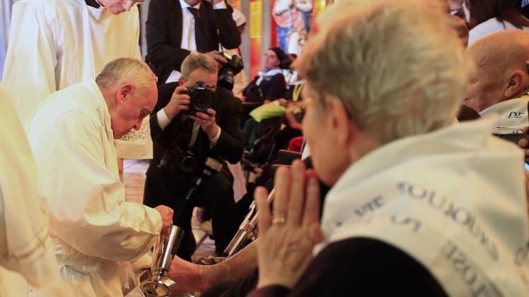 Pope Francis washes a foot of a disabled person at the S. Maria della Provvidenza church in Rome
