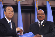 United Nations Secretary General Ban Ki-Moon, left, and South African President Jacob Zuma, right, shake hands as they met at the African Union Summit in Addis Ababa, Ethiopia, Monday, Jan. 30, 2012. (AP Photo/Elias Asmare)
