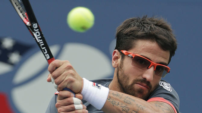 Janko Tipsarevic of Serbia returns a shot to Spain's David Ferrer during the quarterfinals of the 2012 US Open tennis tournament, Thursday, Sept. 6, 2012, in New York. (AP Photo/Peter Morgan)