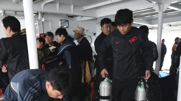 "Divers from a private company prepare for a search and rescue operation near the capsized passenger ship ""Sewol"" off Jindo"
