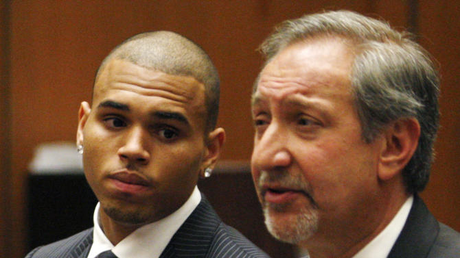 FILE - In this Aug. 25, 2009 file photo, Chris Brown looks on alongside his attorney Mark Geragos during his sentencing for assaulting his girlfriend Rihanna, at Los Angeles County Superior Court in Los Angeles. Brown returns to a Los Angeles court on Wednesday, Feb. 6, 2013, for a hearing in which prosecutors want a judge to revoke his probation and order him to re-do his community labor because of concerns about the accuracy of records provided by Virginia authorities. Brown remains on probation for the 2009 beating of Rihanna. (AP Photo/Rick Loomis, Pool, File)