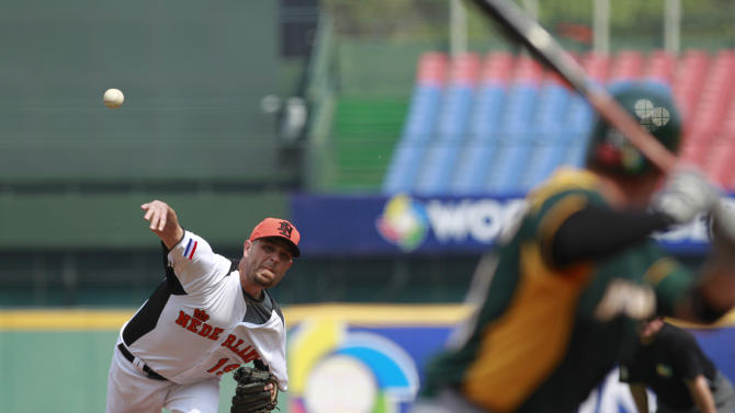 The Netherlands' starter Rob Cordemans (19) delivers a pitch against Australia's leftfielder Luke Hughes in the first inning of their World Baseball Classic first round game at the Intercontinental Baseball Stadium in Taichung, Taiwan, Tuesday, March 5, 2013. The Netherlands won 4-1. (AP Photo/Wally Santana)