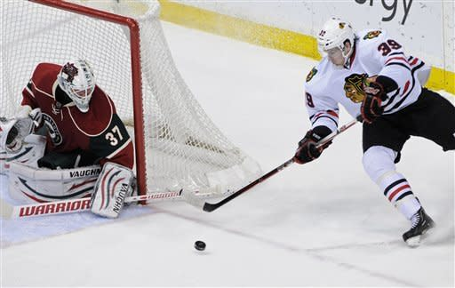 Hawks blow late lead in 2-1 shootout loss to Wild