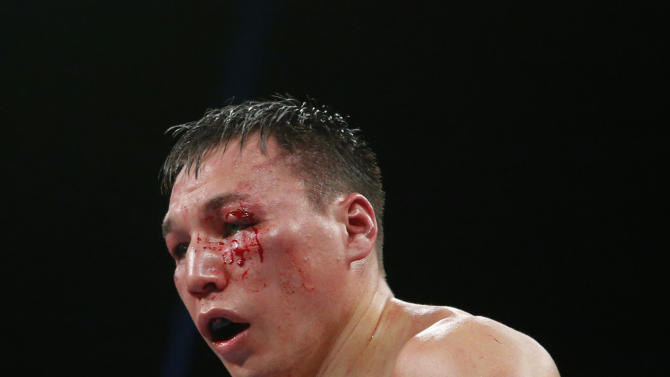 Ruslan Provodnikov, of Russia, bleeds in the ninth round of a WBO welterweight title boxing match against Timothy Bradley in Carson, Calif., Saturday, March 16, 2013. (AP Photo/Jae C. Hong)
