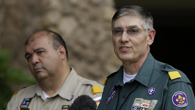 Boy Scouts of America Wayne Perry, right, addresses reporters questions as BSA National Commissioner Tico Perez, left rear, watches Thursday, May 23, 2013, in Grapevine, Texas. Local leaders of the Boy Scouts of America voted Thursday to ease a divisive ban and allow openly gay boys to be accepted into the nation's leading youth organization — one of the most dramatic moves the organization has made in a century. (AP Photo/Tony Gutierrez)