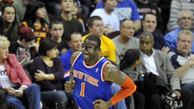 Mar 4, 2013; Cleveland, OH, USA; New York Knicks power forward Amar'e Stoudemire (1) celebrates a basket against the Cleveland Cavaliers in the fourth quarter at Quicken Loans Arena. (David Richard-USA TODAY Sports)