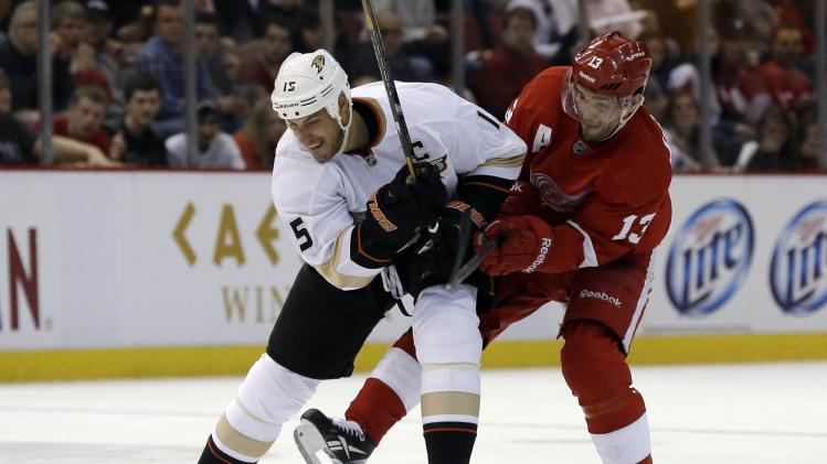 Anaheim Ducks center Ryan Getzlaf (15) and Detroit Red Wings center Pavel Datsyuk (13), of Russia, vie for the puck during the second period in Game 3 of a first-round NHL hockey Stanley Cup playoff series in Detroit, Saturday, May 4, 2013. (AP Photo/Paul Sancya)