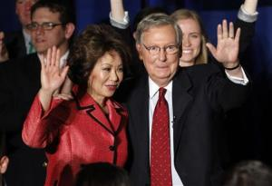 U.S. Senate Republican Leader Sen. Mitch McConnell and wife Elaine Chao wave to crowd of campaign supporters after defeating Tea Party challenger Matt Bevin in states Republican primary elections in Louisville